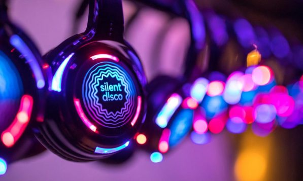 Silent discos are a style of headphone-only party where up to 3 DJs or set lists can playback simultaneously.