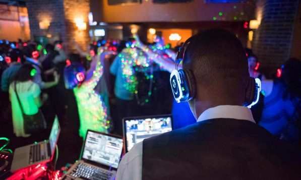 Silent disco headphones often illuminate to correspond to the audio channel they are receiving. Photo credit: Dashanchia, Wikipedia