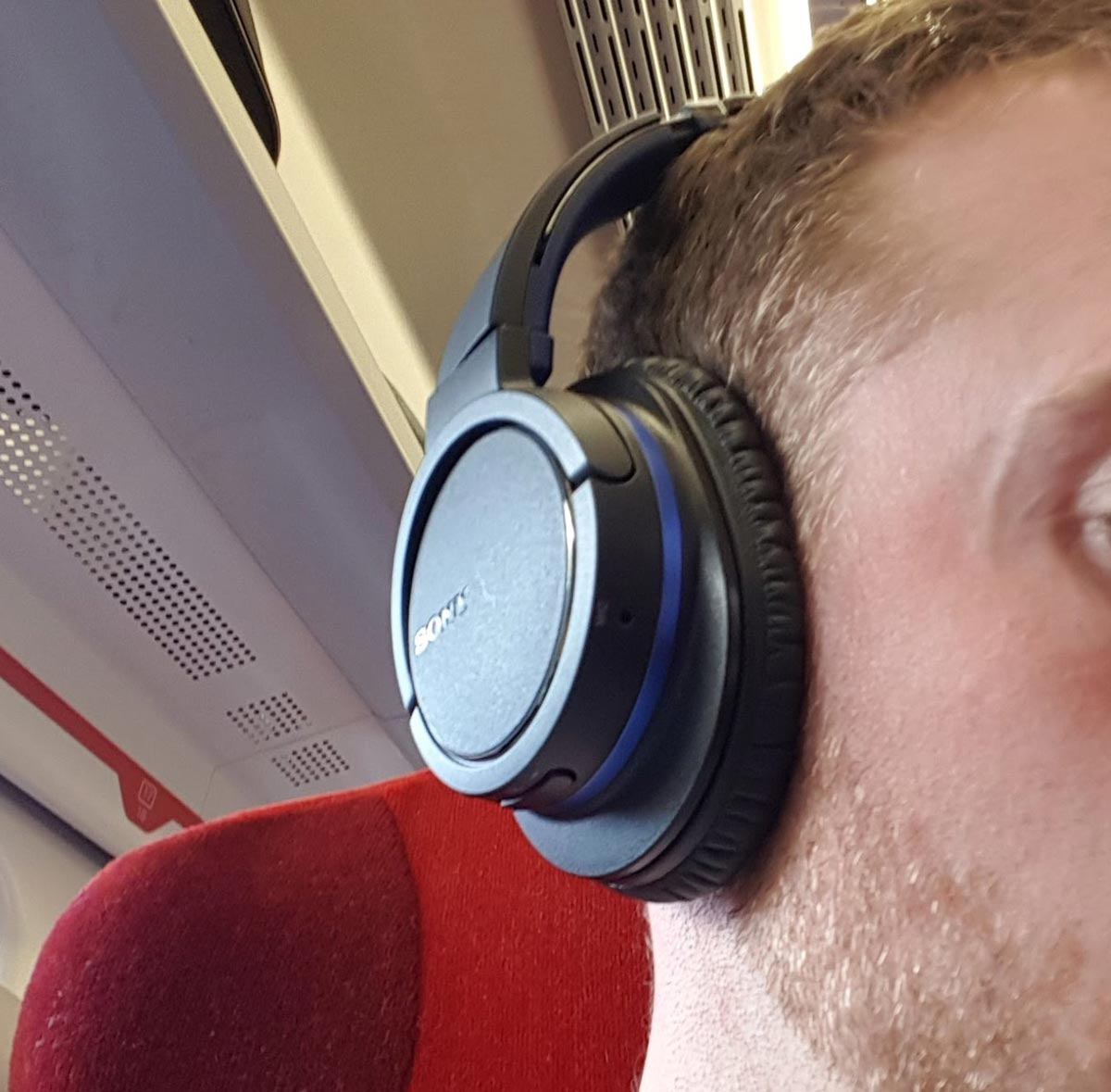 An image of these Sony wireless noise cancelling headphones being worn on the ears
