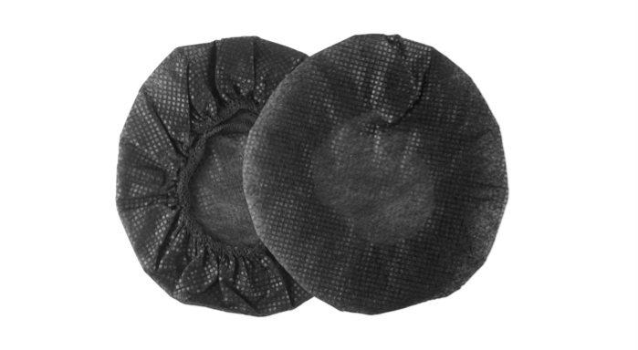 A pair of single use headphone hygiene covers